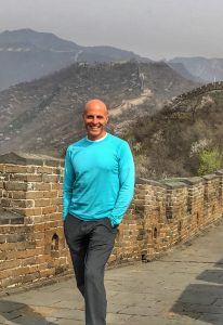 Tim standing on the Great Wall of China