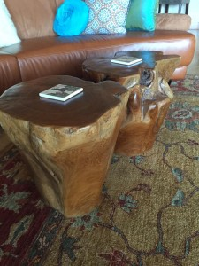 Two teak tree trunks are used in the living room so it would not be too formal