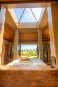 The pyramid skylight spans the exact dimension of the king size bed below.  Not a room for an afternoon nap!