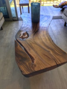 A teak slab cocktail table from Indonesia