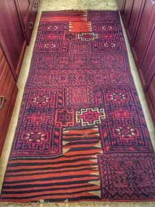A camel rug - literally used on the back of a camel - graces the kitchen