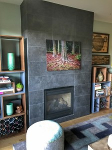 Fireplace we re-faced with 12x24 charcoal tiles by Bedrosian